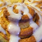 Heavenly Cinnamon Rolls - The secret to this raisin-filled, fluffy masterpiece of a cinnamon roll is the applesauce in the dough. Even though there's no butter in this recipe, this one will blow you away.