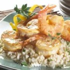 Shrimp Francesca - Large shrimp and chunks of artichoke hearts are covered with crumbs, drizzled with garlicky butter and Romano cheese, and baked in the oven for just a few minutes until shrimp are tender and pink.