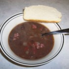 Black Bean Soup I - Sauteed onion and tomato are added to black beans which have been cooked with a ham bone is this basic bean soup.