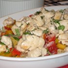 Chicken Pasta Primavera - Tomato and chile sauce with colorful bell peppers is served with tender chicken breast and angel hair pasta.