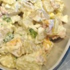 Chunky and Creamy Potato Salad - Little baby potatoes cozy up to chopped hard-boiled eggs, bacon, broccoli, and Cheddar cheese in a ranch dressing with dill weed for a colorful potato salad.