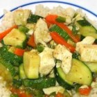 Chicken with Couscous - Fragrant with ginger, curry and coriander, this chicken and vegetable stew gets plenty of heat from plenty of jalapenos.