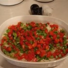 Holiday Shrimp Dip - A layered shrimp and cream cheese dip gets a holiday garnish of bright red and green bell peppers.