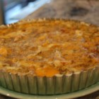 Best Chicken Quiche - Using a few shortcuts--prepackaged pie crust and onion soup mix--this Gruyere and Parmesan quiche can be made with a minimum of effort.
