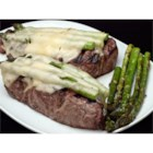 Xavier Steak - The addition of asparagus spears and Swiss cheese make these New York steaks exciting.