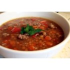 Lentil and Sausage Soup - Lentil soup flavored with sausage and herbs. Serve with Romano cheese sprinkled on top of each serving bowl.