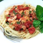 Basil Chicken over Angel Hair - Cubed chicken breast is simmered in a peppery tomato-basil sauce and tossed with fine strands of angel hair pasta.