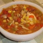Mexican Soup - Shredded chicken in a cumin-spiced soup with kidney beans, corn, tomatoes, red and green bell pepper, and green chiles.