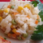 Mexican White Rice - This rice side dish features fresh corn, peas, carrot, and poblano pepper for a great accompaniment to any Mexican main dish.