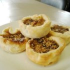 Canadian Butter Tarts -  This recipe makes twelve tarts filled with raisins and a wonderful brown sugar, toasted coconut, and walnut mixture that bakes up gooey, sweet and absolutely delicious. Top with a dollop of unsweetened whipped cream.