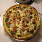 Spinach and Red Chard Quiche - This quiche has spinach, Swiss chard, onions, garlic, a slew of yummy spices, tofu, milk, parmesan and Cheddar cheese.  But no eggs!