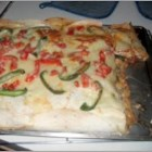 Colorado Mexican Pizza - A large layered pizza with chicken and ground beef made with a crust of flour tortillas