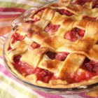 Rhubarb and Strawberry Pie - Sugar and flour are combined with strawberries and rhubarb, poured into a prepared crust, and topped with another crust. A delicious tart and sweet combination.