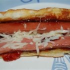 Monte Cristo Hotdog - This recipe makes a hot dog and bun both pan-fried in melted butter and served with Swiss cheese and strawberry jam.