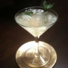 Cuban Mojito - Enjoy Cuba's traditional cocktail that blends lime juice, mint sprigs, rum, and club soda in a refreshing drink. Serve with a straw and a decorative stir stick to keep the different flavors well mixed together.