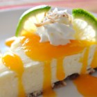 Coconut-Lime Cheesecake with Mango Coulis - This tropical-inspired cheesecake features a ginger-coconut crust and two divine layers topped off with a fresh mango coulis.