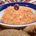 Greek Feta And Olive Spread - Feta cheese, sun-dried tomatoes and black olives come together as one in this full-flavored Greek dip. Serve it on toasted triangles of pita bread.