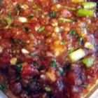 Jill's Salsa - This quick and easy salsa can be made in just a few minutes with a food processor. Green onions instead of white onions give it a nice, mellow flavor to balance the kick of the jalapenos. This recipe also works well with 2-3 habanero peppers instead of the jalapenos.  But be sure to remove the seeds and membrane from the habaneros first! Grab a bag of tortilla chips, dip, eat, and enjoy!