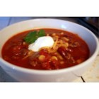 Slow Cooker Taco Soup - Browned ground beef seasoned with a package of taco seasoning is combined in a slow cooker with canned beans, tomatoes, and green chilies.  Serve with tortilla chips and a dollop of sour cream.