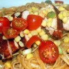 Rainforest Chicken and Pasta - Seasoned chicken breasts are grilled, sliced, and served over fettuccine pasta with a cooked corn and tomato salsa. There's a bit of Cajun heat in this recipe.