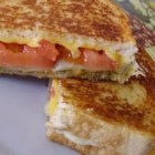 Pesto Grilled Cheese Sandwich - Give your grilled cheese sandwich an Italian flair by adding provolone cheese, tomato, and pesto.