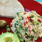 Quinoa Tabbouleh - Quinoa, once a staple grain of ancient Incas, is tossed with lemon juice, tomatoes, cucumber, carrots, green onions and parsley.  Serve with pita bread.