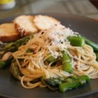 Pasta with Asparagus - Tender spears of fresh asparagus are simmered with chicken broth and sliced mushrooms. Tossed with angel hair pasta and Parmesan cheese, this makes a wonderful luncheon dish or light supper.