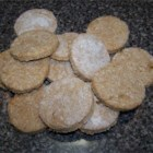 Peanut Butter and Banana Dog Biscuits - Crisp and crunchy, these easy-to-make, rolled, cut-out dog cookies combine peanut butter, honey, and an egg with whole wheat flour and wheat germ.