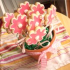 Cut-Out Cookies in a Flower Pot - Tender sugar cookies shaped like flowers and baked on sticks are arranged in a flower pot.