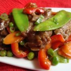 Filipino Beef Stir-Fry - This simple dish consists of marinated beef stir-fried with onion, garlic, snow peas, green peas, carrot, celery, and red bell pepper.