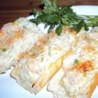 Shrimp and Crabmeat Loaf - This is a quick and easy seafood salad spread made of shrimp, crab, mayonnaise, green onions, and mozzarella cheese. It can be served immediately after being made or heated in the oven.