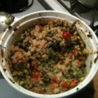 Spinach Veggie Casserole - Lots of spinach, lots of rice and lots of cheese in this hearty casserole. Cheddar cheese, hot sauce and spinach are added to a flour roux, and then combined with vegetables and rice in a large casserole dish. Makes four generous servings.