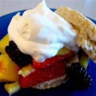 Summery Lime-Mango Shortcakes - Mango, blueberry, and strawberry topped shortcakes, filled with coconut cream, are sunny treats that are perfect any time of the year.