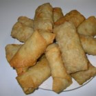 Awesome Egg Rolls - Shrimp, cabbage, carrots, and bean sprouts are seasoned with garlic powder and soy sauce, then wrapped up tight, and deep fried to a golden brown finish. Delicious with hot mustard. Use shredded chicken or pork, if you like.