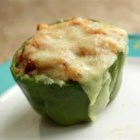 Green Bell Peppers stuffed with Tomato Lentil Couscous - Packaged tomato lentil couscous make for short preparation of this ground beef stuffing. The peppers are topped with cheddar cheese and baked.