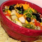 Tortilla Chicken Vegetable Soup - Chopped peppers, cilantro and corn are added to this chicken and rice soup seasoned with cumin and cayenne pepper.  Serve with crushed tortilla chips and crumbled asedero cheese.