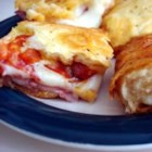 Antipasto Squares - Layers of roasted red bell pepper and deli meats cheeses are baked inside a crescent roll crust.