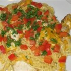 Chicken or Turkey Tetrazzini - Warm up a cold night with a satisfyingly creamy bake of chicken or turkey in cream of mushroom soup and American cheese with spaghetti noodles. A sprinkling of chopped parsley and bell peppers adds colorful crunch.