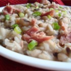 Hoppin' John - This flavorsome dish from the American South combines black-eyed peas, onion, ham hock and long-grain rice in a satisfying, simmered pilaf. A sprinkling of smoked Cheddar cheese melts lusciously over the top.