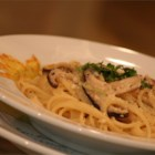 Shiitake Angel Hair Pasta - Fresh shiitake mushrooms, sauteed in garlic and onion, is simmered in a reduction of wine, stock and cream, then tossed with delicate strands of angel hair pasta and served with a dusting of Parmesan and parsley.