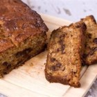 Chocolate Chip Banana Bread II - Rich and sweet with chocolate chips and walnuts, this banana bread is made with shortening and mayonnaise, making it very moist. This recipe makes 2 loaves.
