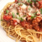 Camp David Spaghetti with Italian Sausage - A hearty ground beef and tomato pasta sauce is mixed with spaghetti, and topped with an Italian sausage and melted Parmesan cheese. Great for Presidents' Day.