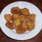 Fried Dill Pickles - Dill pickle slices are breaded, then deep fried in peanut oil. A great snack.