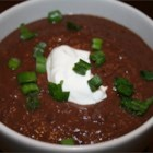 Black Bean and Salsa Soup - Black beans, salsa, veggie broth and cumin are tossed into the blender. Transfer to a pot and heat until warm and bubbly. Serve with a dollop of sour cream and a sprinkling of green onion.