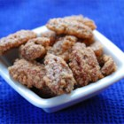 Sugar Coated Pecans - These slow-roasted whole pecans coated in an egg white and sugar glaze spiced with cinnamon make a wonderful snack for any occasion.