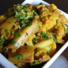 Aloo Gobi - Traditional Indian dish made of spiced cauliflower and potatoes. This dish is steamed and then fried in oil making it intentionally dry and somewhat crispy.