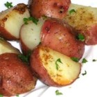 Lemon Horseradish New Potatoes - New potatoes are baked in a savory sauce of butter, horseradish and lemon juice.  Spoon the sauce over the potatoes when serving, and garnish with fresh parsley and lemon wedges, if desired.