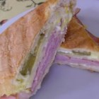 Cuban Midnight Sandwich - Hoagie rolls are stuffed with sliced ham, turkey and Swiss cheese, then grilled in a skillet until the cheese is melted.