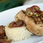 Grilled Tuna Steaks with Grape and Caper Salsa - Grilled tuna steaks are topped with an unusual sweet and tangy salsa in this dish.