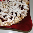 Funnel Cakes II - These are Pennsylvania Dutch cakes. The batter is poured through a funnel into cooking oil and fried, then sprinkled with confectioners' sugar.
